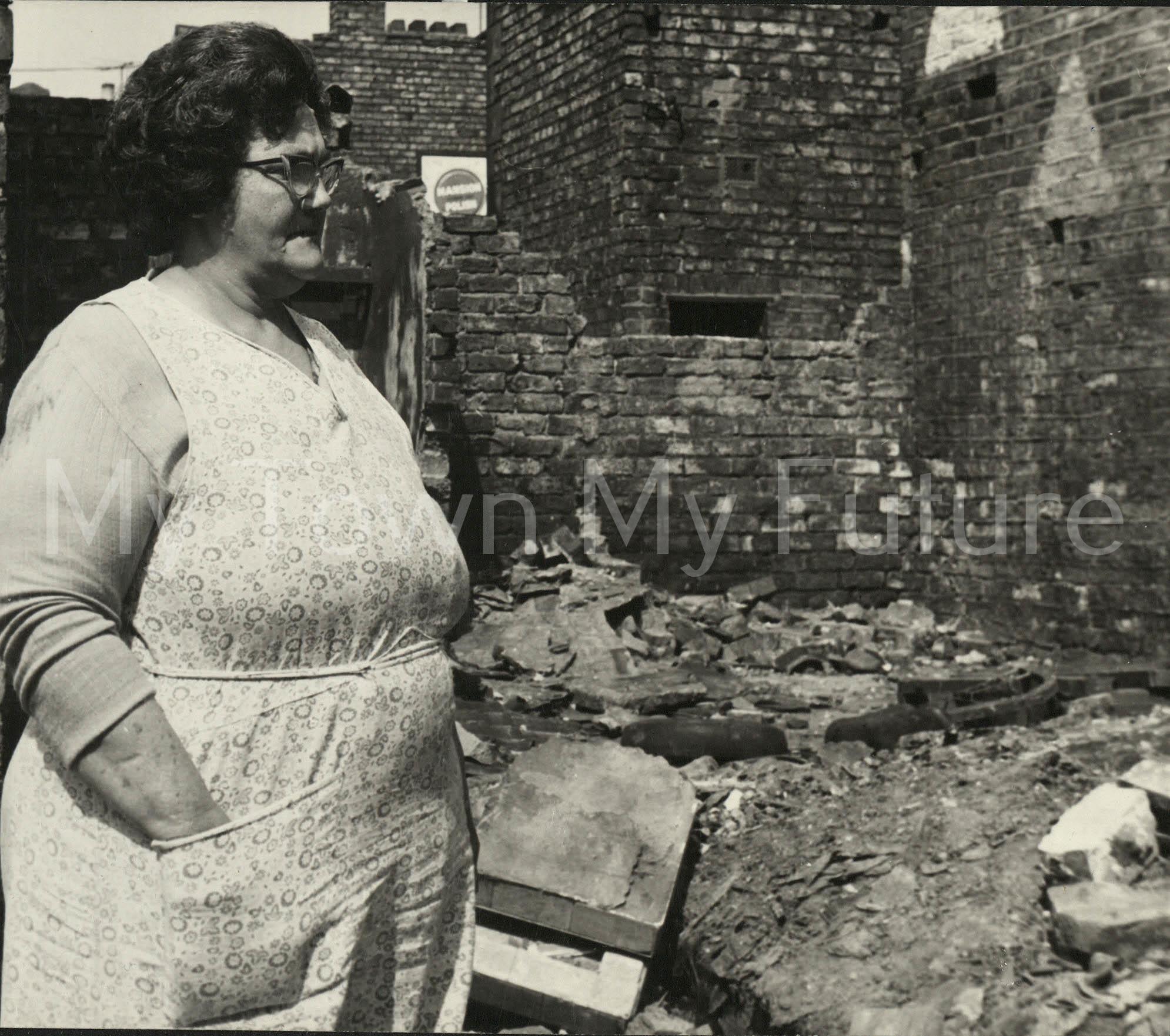 Mrs Violet Ferguson surveys the scene at the rear of her house.