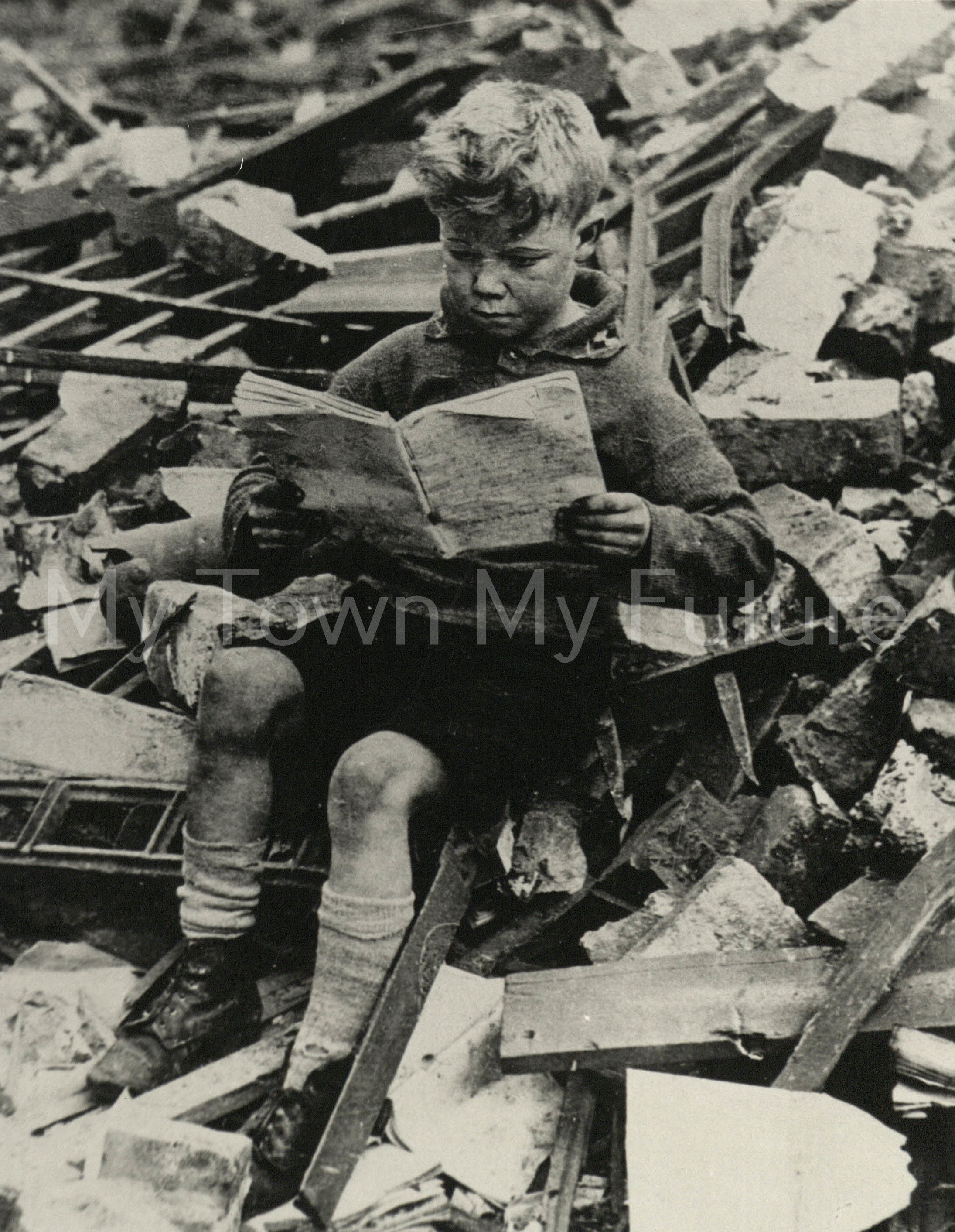 Desmond Taylor 8yr sitting in the ruins of St Pauls School Newport Rd