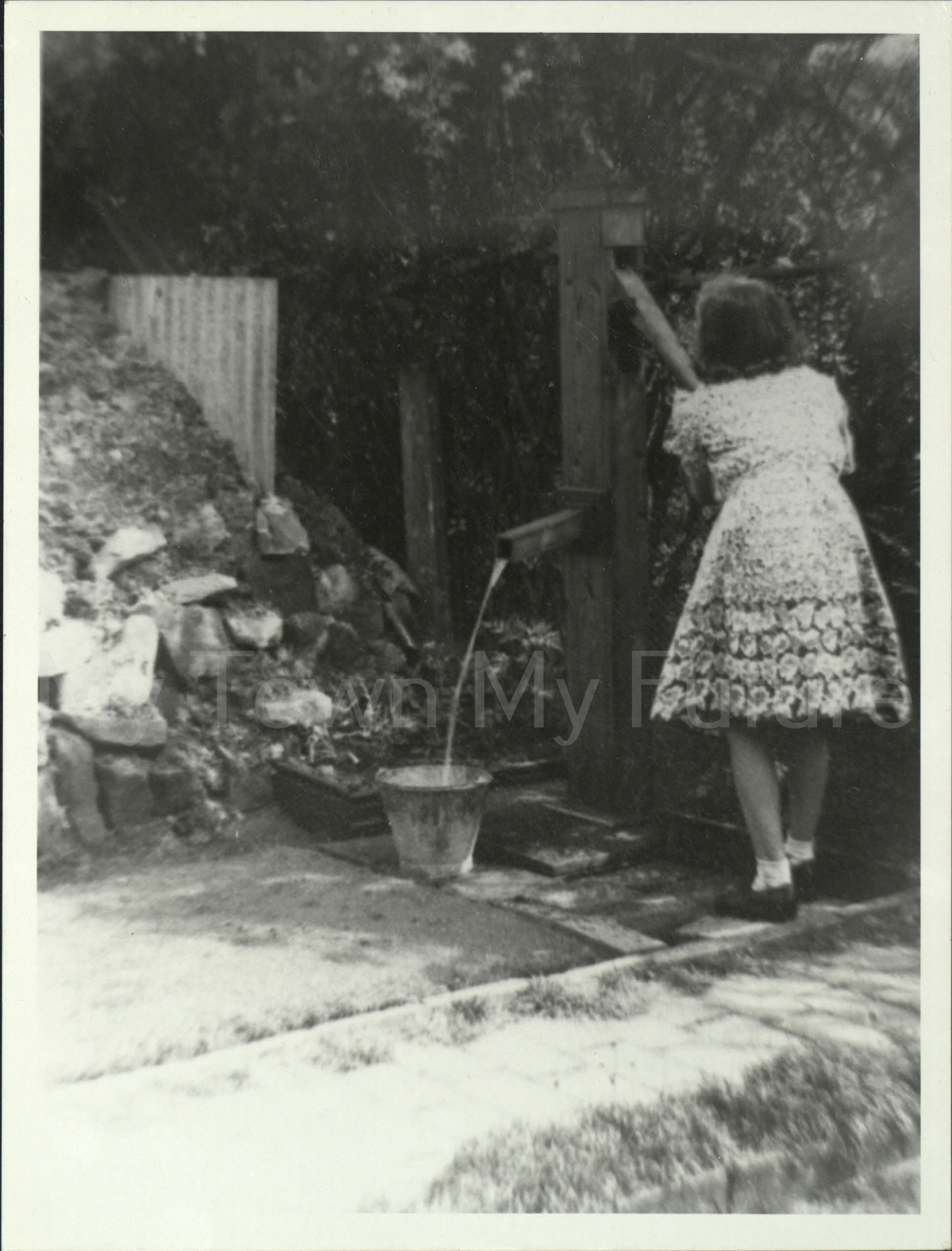 World War II Civillians Anderson Shelter at 11 Eastbourne Road 1939 Girl using a Standpipe to draw water